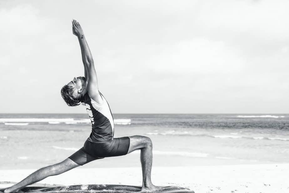 Osteoarthritis, man stretching on beach