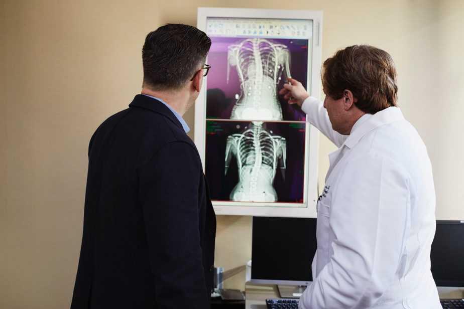 two doctors examining xray