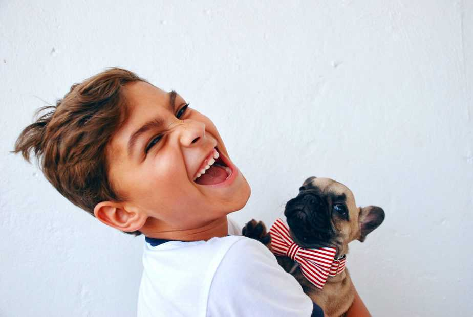 Boy laughing with dog, personality