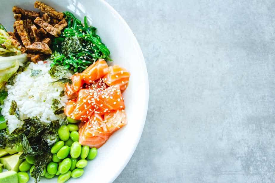photo of a plate with salmon, soy beans, white rice