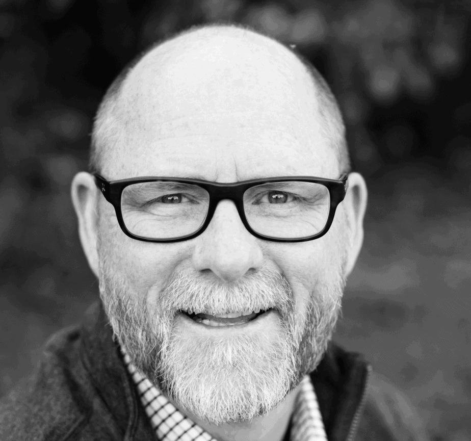 bald man with glasses black and white