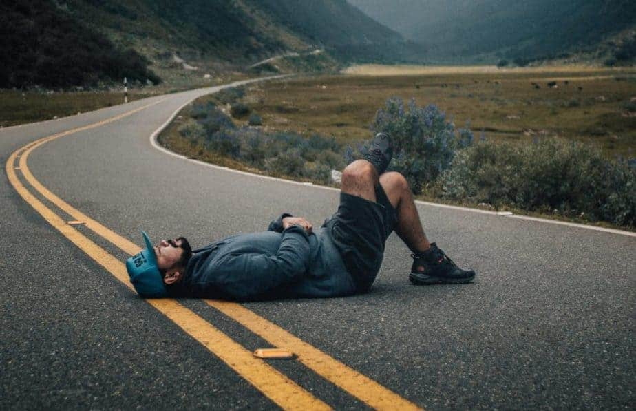Man lying on road, syncope