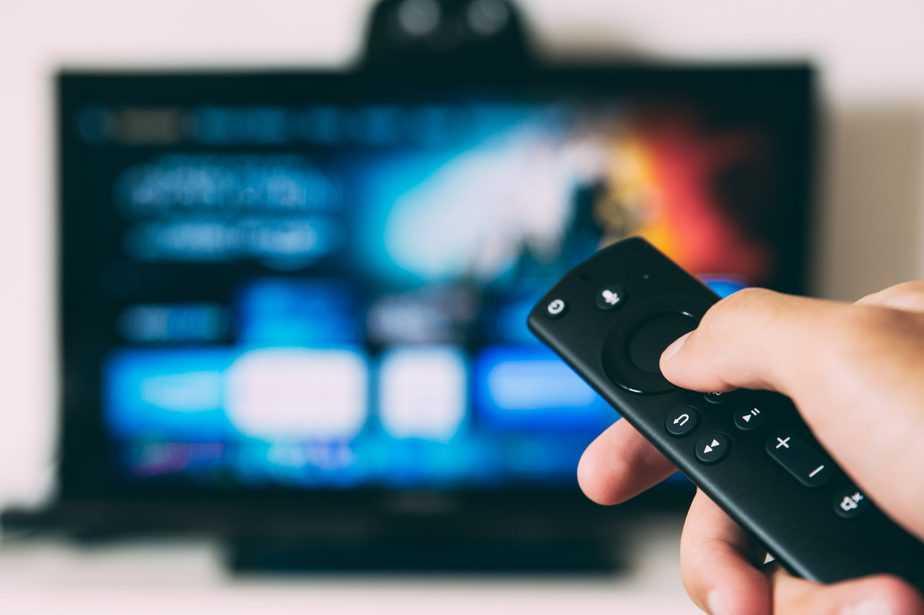 person using television remote