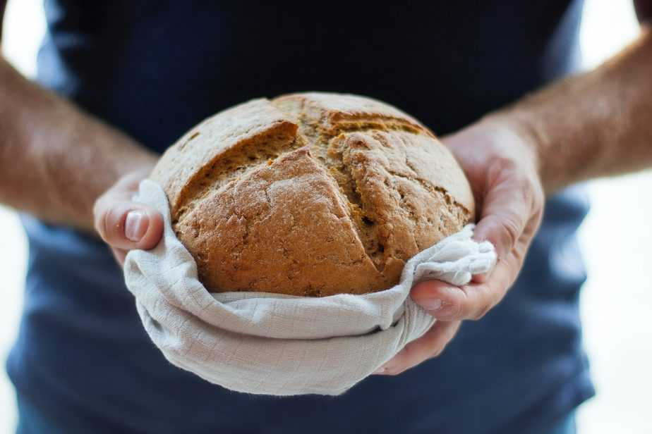 person holding loaf of bread