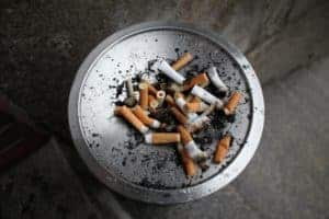 tray of cigarette butts