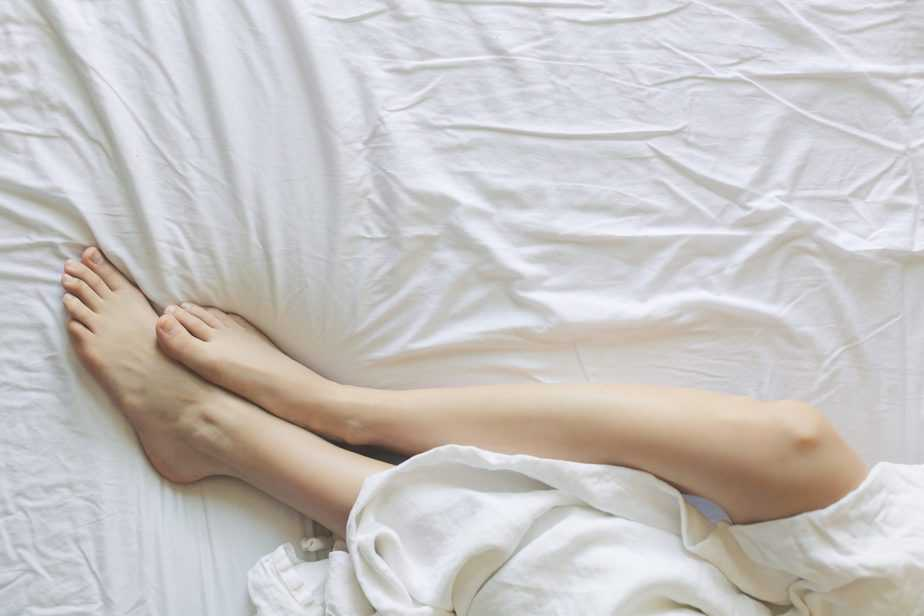 asleep on bed with legs showing